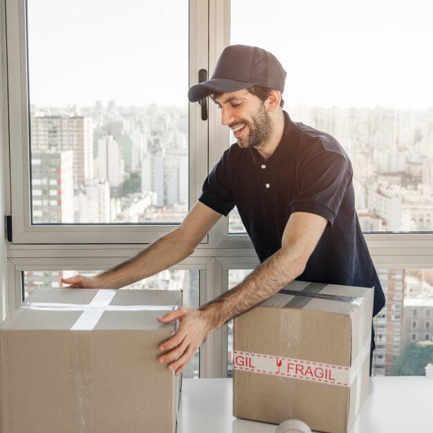 delivery-man-preparing-package-shipment_23-2147862251.jpg